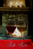 Romantic old fashioned fireplace interior with wine glasses Stock Image