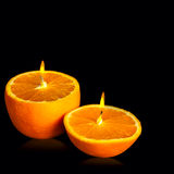 Romantic orange -shaped candle Stock Images