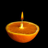 Romantic orange -shaped candle Stock Photos