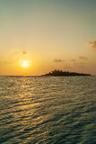 Romantic orange sunset with tropical island, Maldives Royalty Free Stock Photography