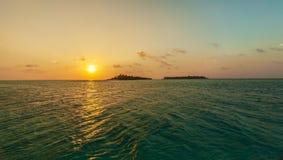 Romantic orange sunset with tropical island, Maldives Royalty Free Stock Image