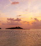 Romantic orange sunset with tropical island, Maldives Royalty Free Stock Photo