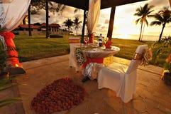 Romantic outdoor dining setup Stock Photos