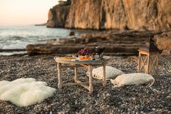 romantic dinner with wine and grapes by seaside Stock Photography