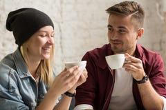 Romantic pair drinking coffee Royalty Free Stock Image