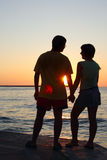 Romantic pair looking at each other at sunset Royalty Free Stock Images