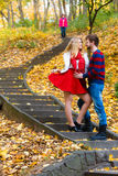 Romantic pair meet in park standing on stairs. Stock Photography