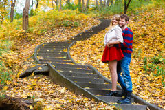 Romantic pair meet in park standing on stairs. Stock Image