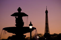 Romantic Paris Scene. Silhouette of the fountain at Place de la Concorde with the Eiffel Tower in the background at dusk Royalty Free Stock Photography