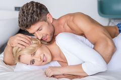 Romantic Partners Lying on Bed Fashion Shoot Stock Photography