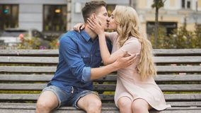 Romantic passionate kiss of young couple in love, man and woman dating royalty free stock photography
