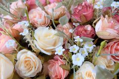 Romantic pastel rose wedding bouquet with red background , retro filter Stock Photos