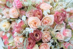 Romantic pastel rose wedding bouquet with red background , retro filter Royalty Free Stock Images