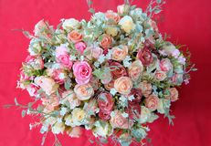 Romantic pastel rose wedding bouquet with red background , retro filter Stock Images