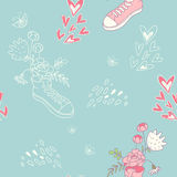 Romantic pattern with sneakers and flowers Royalty Free Stock Image