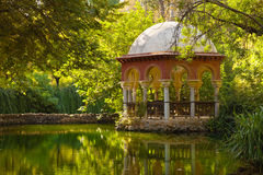 Romantic pavilion reflected in a pond. Royalty Free Stock Photography