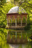 Romantic pavilion reflected in a pond Stock Images