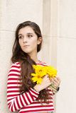 Romantic and pensive beautiful woman with flower bouquet looking Stock Photos