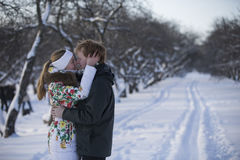 Romantic photo of cute couple outdoors in winter. Young man and Stock Images