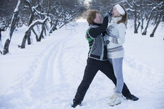 Romantic photo of cute couple outdoors in winter. Young man and Stock Image