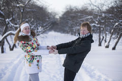 Romantic photo of cute couple outdoors in winter. Young man and Royalty Free Stock Image