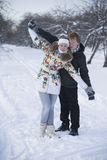 Romantic photo of cute couple outdoors in winter. Young man and Stock Photos