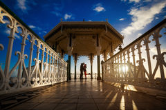 Romantic photo of kissing couple during sunset. Made in Brighton, England Royalty Free Stock Photos