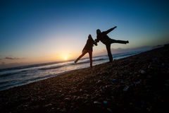 Romantic photo of kissing couple during sunset. Made in Brighton, England Stock Photos