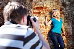 Romantic photo shoot with woman. Romantic photo shoot near the old brick wall Royalty Free Stock Photos