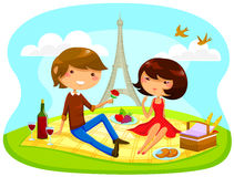 Romantic picnic. Boy and girl having romantic picnic next to the Eiffel tower Royalty Free Stock Photo