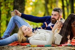 Romantic picnic forest. Couple in love tourists relaxing on picnic blanket. Vacation weekend picnic camping and hiking royalty free stock image