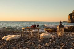 Romantic picnic with wine and cheese by seaside Stock Photography