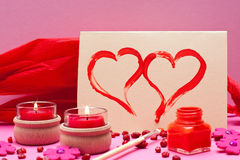 Romantic pink background with red candles Royalty Free Stock Photography
