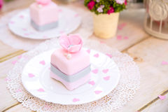 Romantic pink cake. With flower and pearl Stock Images