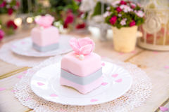 Romantic pink cake. With flower and pearl Stock Photos