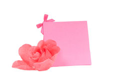 Romantic pink gift card and a flower isolated. Pink blank gift card and a red rose isolated on white background Stock Image