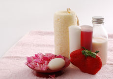 Romantic pink SPA set with huge strawberry Royalty Free Stock Images