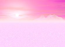 Romantic Pink Sunsetting over a distant Mountain Royalty Free Stock Photos