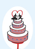 Wedding Cake. Romantic pink wedding cake with bride and groom decorated with blue hearts and white sugar circles Royalty Free Stock Photography