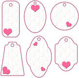 Romantic pink and white tags with hearts Stock Photos