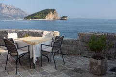 Romantic place. Nice open-air restaurant with romantic athmosphere and sea-view Royalty Free Stock Images