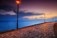 Romantic place with amazing sunset Mediterranean sea,Rovinj,Croatia,Europe. Spectacular relaxing place with romantic promenade and magical sunset,Rovinj,Istria Royalty Free Stock Images