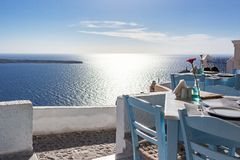 Romantic place for dinner with sunset in Oia Santorini Greece royalty free stock images