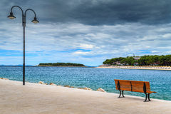 Romantic place with Mediterranean sea,Primosten,Croatia,Europe. Spectacular relaxing place with romantic promenade and idyllic green island in background Royalty Free Stock Photo