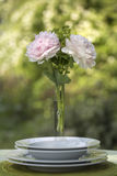 Romantic place setting with pink peonies Stock Photo