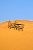 Romantic place to sit on the Sahara desert Royalty Free Stock Image