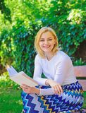 Romantic poem. Enjoy rhyme. Woman happy smiling blonde take break relaxing in garden reading poetry. Girl sit bench. Relaxing with book, green nature background stock photos