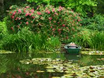 Romantic pond. And old boat Royalty Free Stock Image