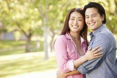 Romantic portrait Asian couple in park Stock Photos