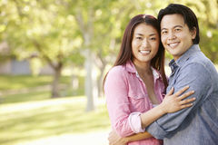 Romantic portrait Asian couple in park Royalty Free Stock Images